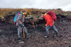Space Intelligence founders Murray Collins and Ed Mitchard walking in peatland.