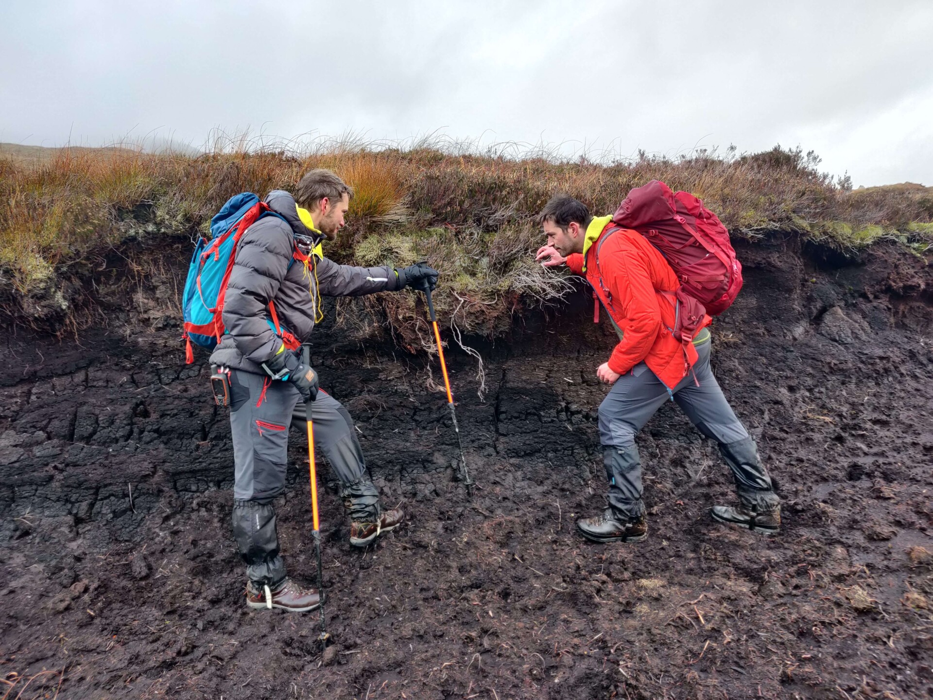 Space Intelligence co-founders Ed Mitchard and Murray Collins walking in peatland